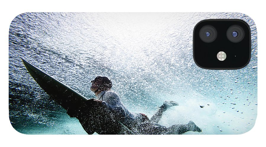 Expertise IPhone 12 Case featuring the photograph Surfer Duck Diving by Subman