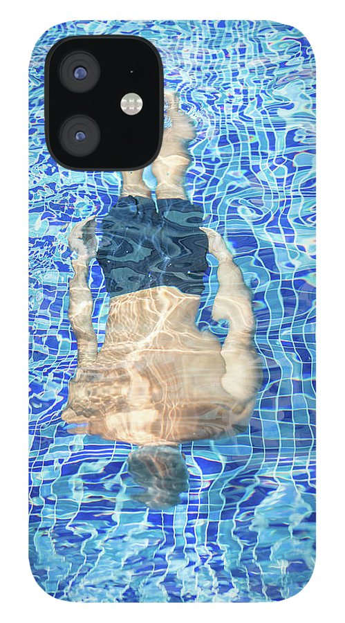 Underwater IPhone 12 Case featuring the photograph Top View Of Man Diving by Jasmin Merdan