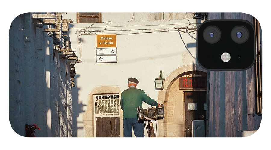 People IPhone 12 Case featuring the photograph Trulli Houses Alberobello Apulia Puglia by Peter Adams