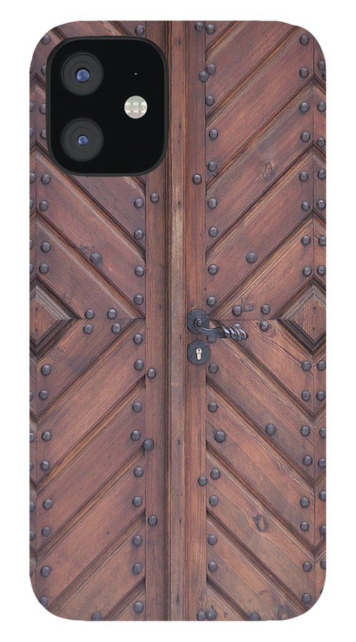 Material IPhone 12 Case featuring the photograph Vintage Wooden Brown Door Close-up by Bogdan Khmelnytskyi