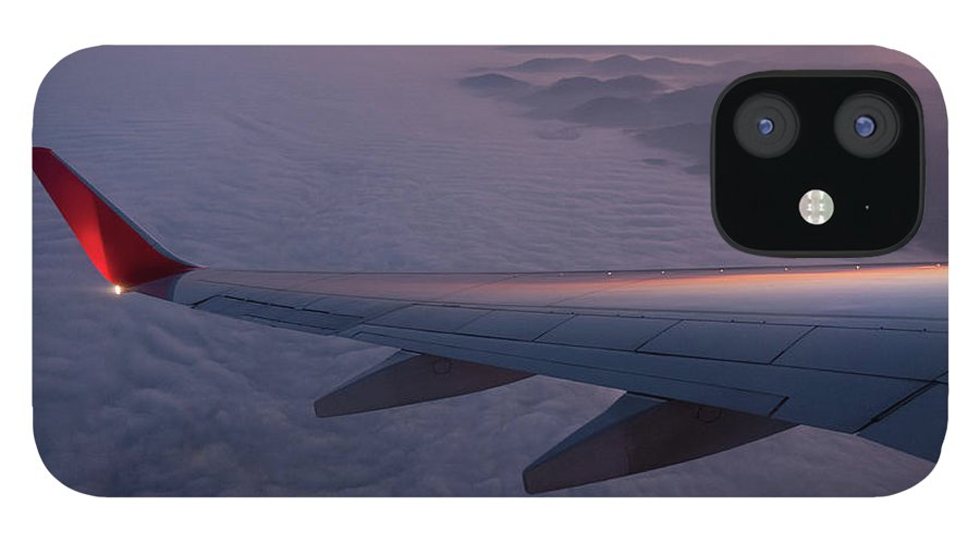Taking Off IPhone 12 Case featuring the photograph Wing Of An Aeroplane With Sunset by Rotofrank