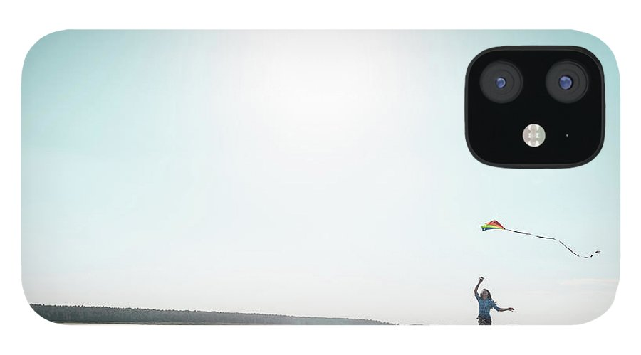 Three Quarter Length IPhone 12 Case featuring the photograph Woman Flying Kite On Beach by Dan Brownsword