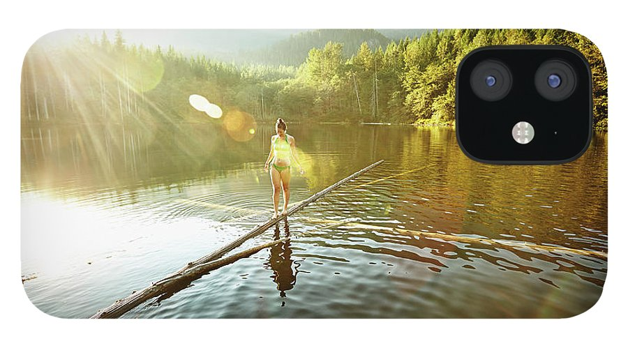Pets iPhone 12 Case featuring the photograph Woman Walking On Log In Alpine Lake by Thomas Barwick