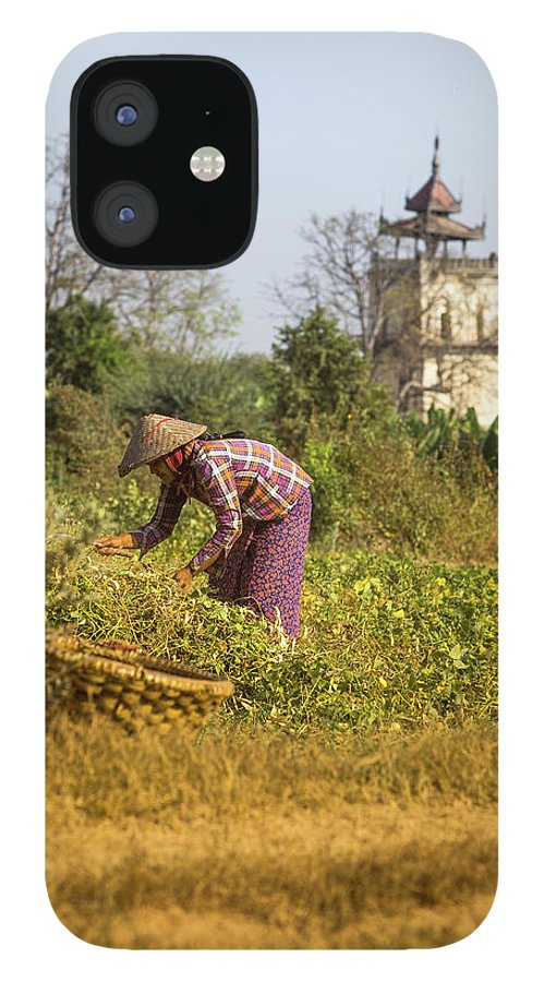 Three Quarter Length IPhone 12 Case featuring the photograph Woman Weeding At Nanmyin Tower by Merten Snijders