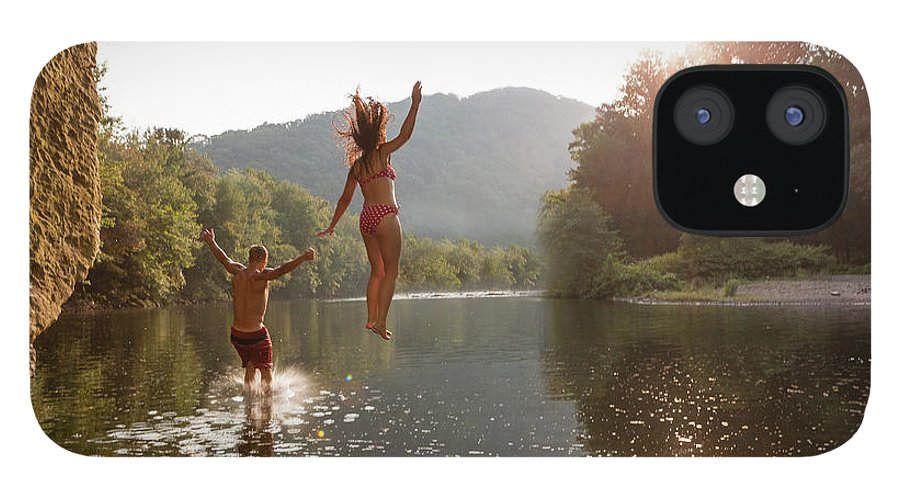 Young Men IPhone 12 Case featuring the photograph Young Couple Jumping Into River by Zave Smith