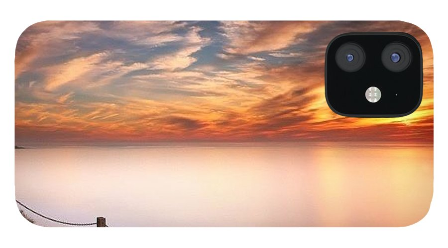 IPhone 12 Case featuring the photograph Long Exposure Of Last Night's Sunset by Larry Marshall