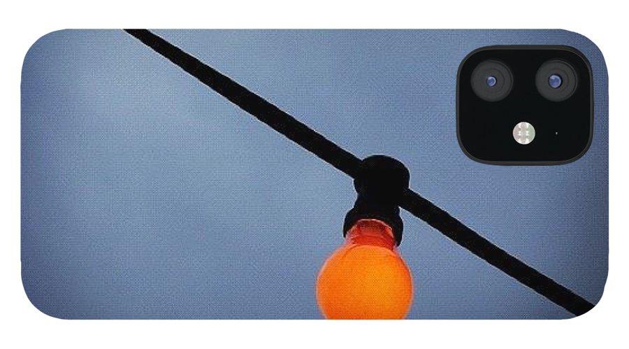 Orange IPhone 12 Case featuring the photograph Orange Light Bulb by Matthias Hauser
