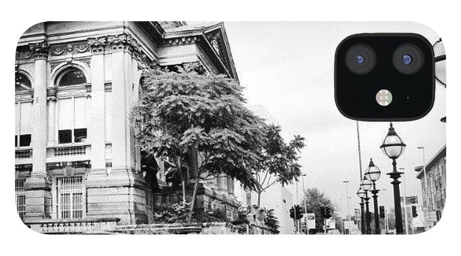 England IPhone 12 Case featuring the photograph #liverpool #uk #england #rainy #rain by Abdelrahman Alawwad