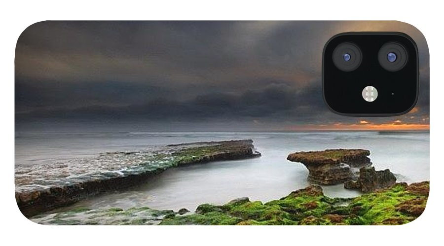 IPhone 12 Case featuring the photograph Long Exposure Of A Stormy Sunset At A by Larry Marshall