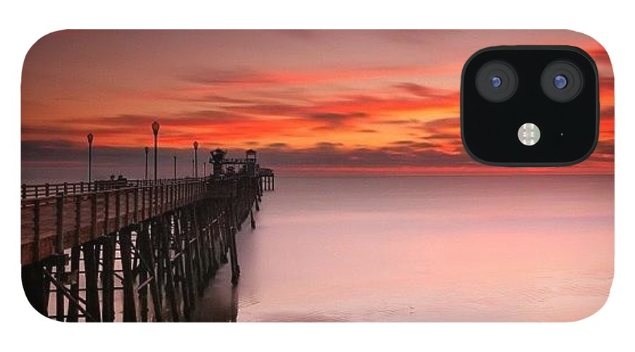All_sunsets IPhone 12 Case featuring the photograph Long Exposure Sunset At The Oceanside by Larry Marshall