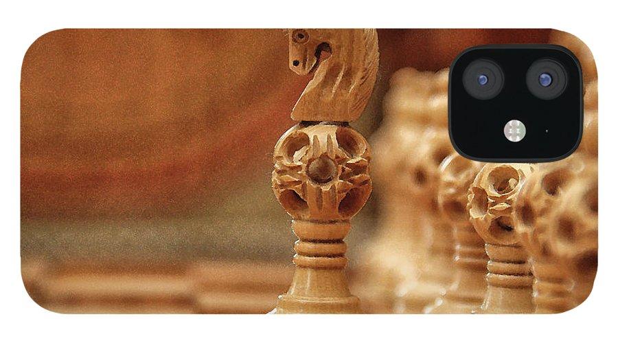 Board iPhone 12 Case featuring the digital art A Lone Knight by Sandeep Gangadharan