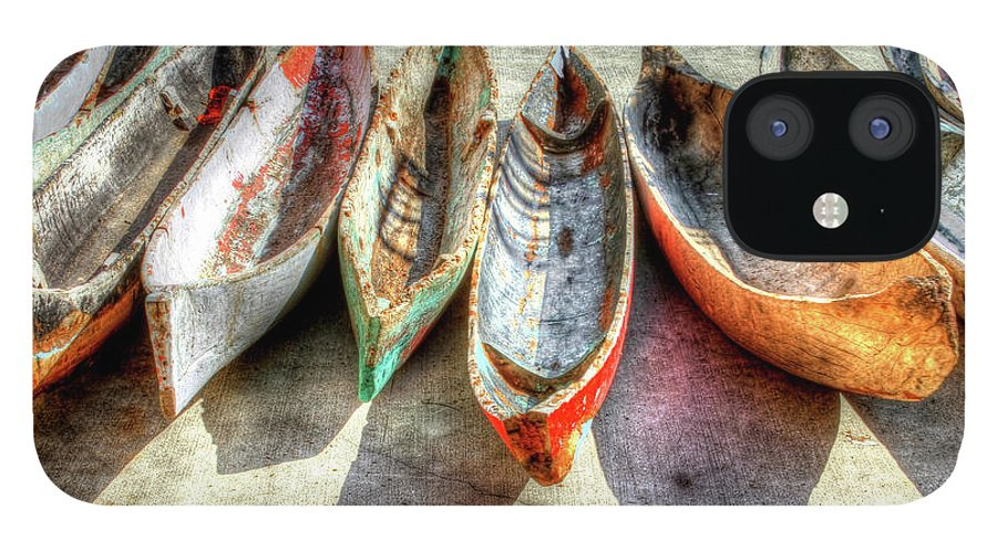 The IPhone 12 Case featuring the photograph Canoes by Debra and Dave Vanderlaan