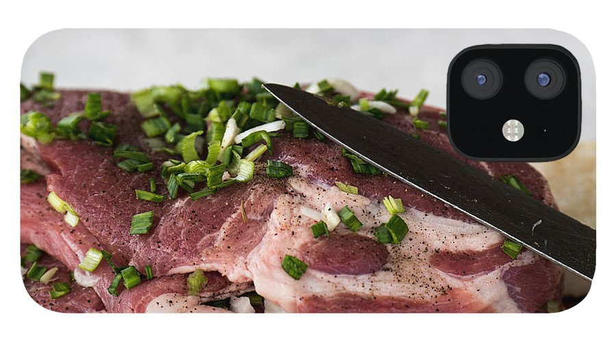 Background IPhone 12 Case featuring the photograph Pork meat with green garlik and knife by Adrian Bud