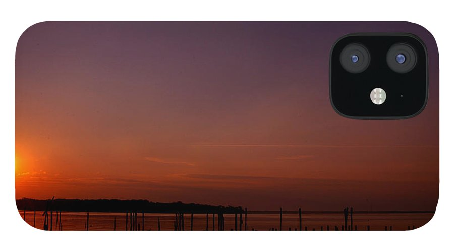 Clay IPhone 12 Case featuring the photograph The Sun Sets Over The Water by Clayton Bruster