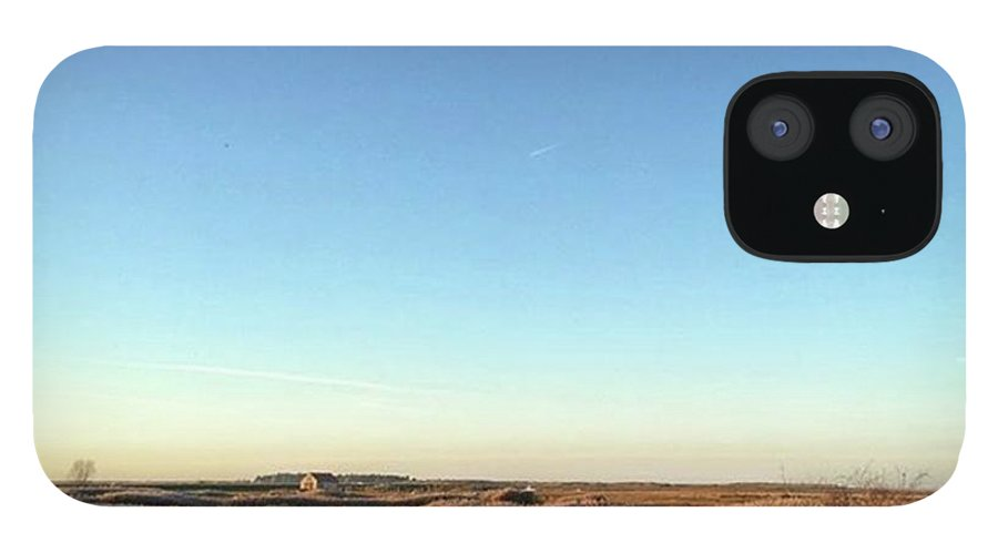 Natureonly IPhone 12 Case featuring the photograph Thornham Marsh Lit By The Setting Sun by John Edwards