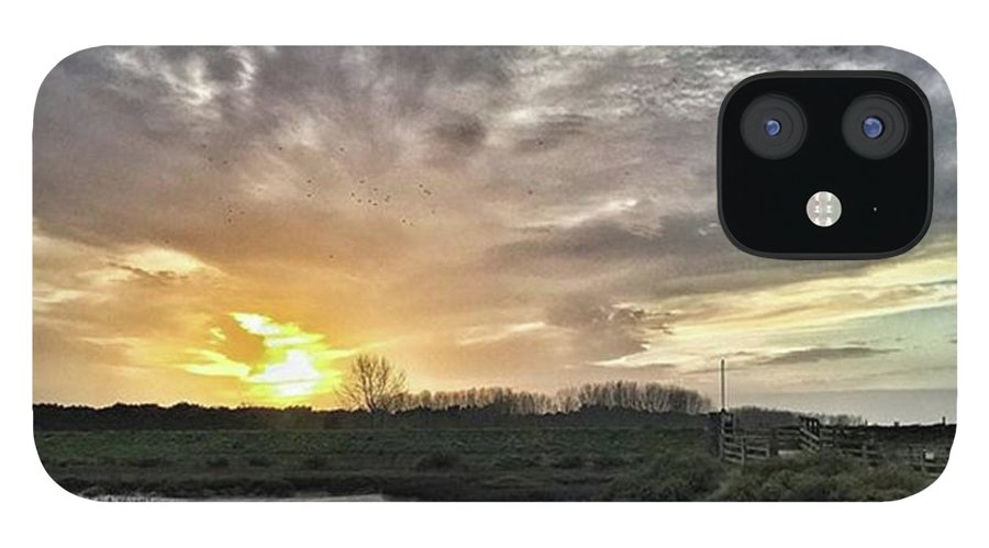 Natureonly iPhone 12 Case featuring the photograph Tonight's Sunset From Thornham by John Edwards