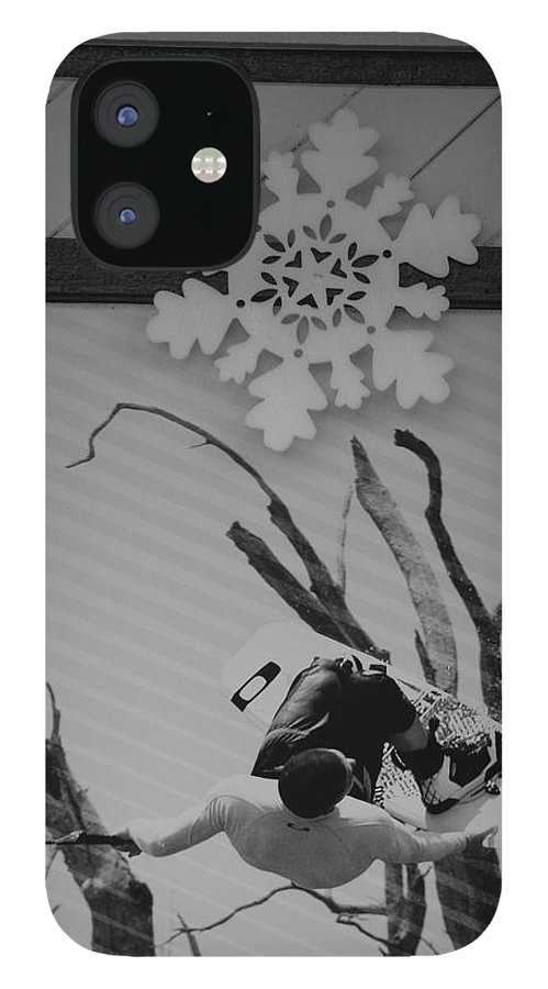 Snow Flake IPhone 12 Case featuring the photograph Wall Surfing With A Snow Flake by Rob Hans