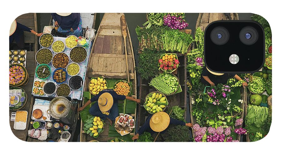 People IPhone 12 Case featuring the photograph A Floating Market On A Canal In by Mint Images - Art Wolfe