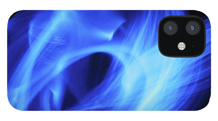 Black Background iPhone 12 Case featuring the photograph Blue Fiber Optic Light Streaks Against by Steven Puetzer