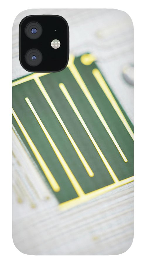 Tin iPhone 12 Case featuring the photograph Close-up Of A Circuit Board by Nicholas Rigg