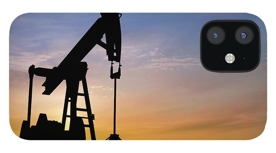 Dawn IPhone 12 Case featuring the photograph Dawn Over Petroleum Pumps In The Desert by Grafissimo