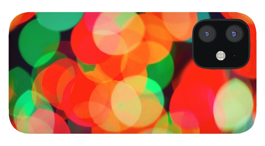 Holiday iPhone 12 Case featuring the photograph Defocused Lights by Tetra Images