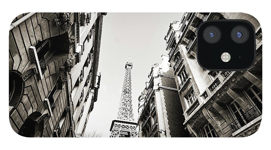 Built Structure IPhone 12 Case featuring the photograph Eiffel Tower Between Buildings In by Flory