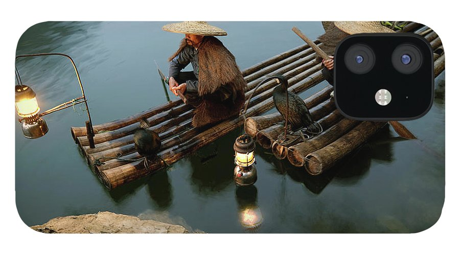 Yangshuo iPhone 12 Case featuring the photograph Fishing With Cormorants by Kingwu