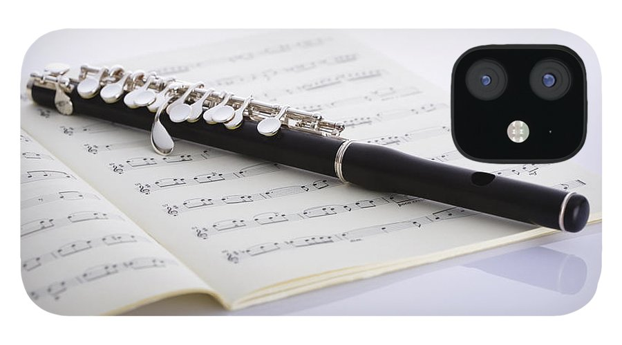 Sheet Music IPhone 12 Case featuring the photograph Piccolo On A Score by Imagenavi