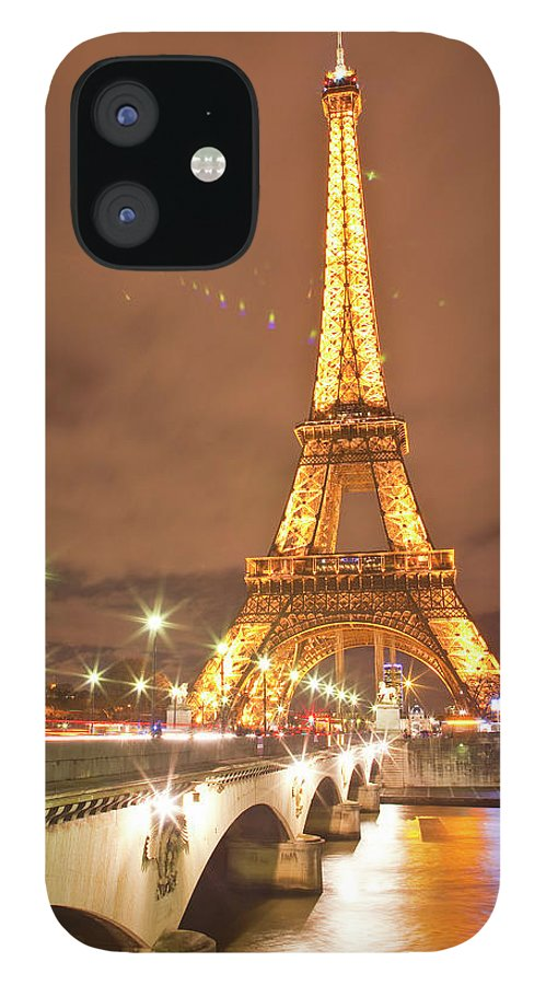 In A Row IPhone 12 Case featuring the photograph The Eiffel Tower Lit Up At Night In by Julian Elliott Photography