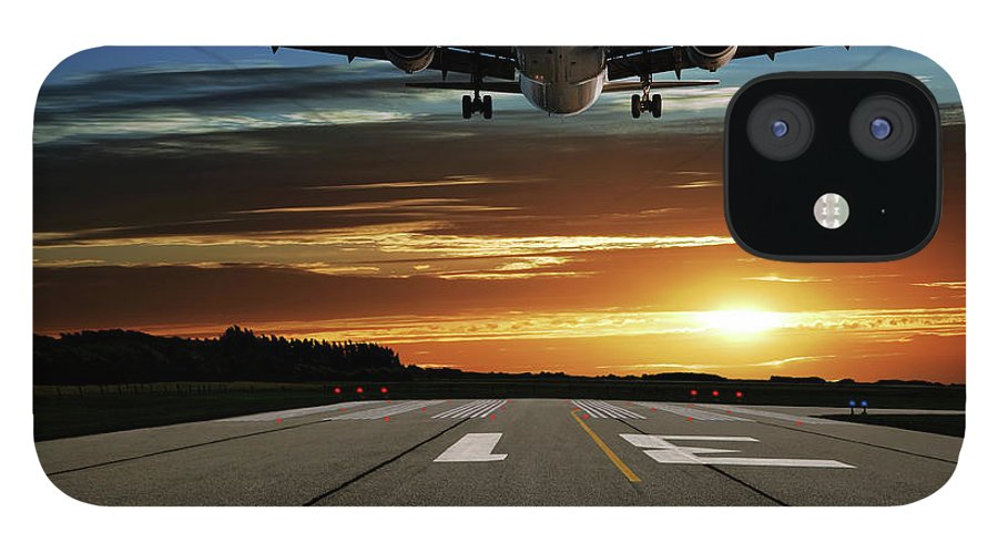 Orange Color IPhone 12 Case featuring the photograph Xl Jet Airplane Landing At Sunset by Sharply done
