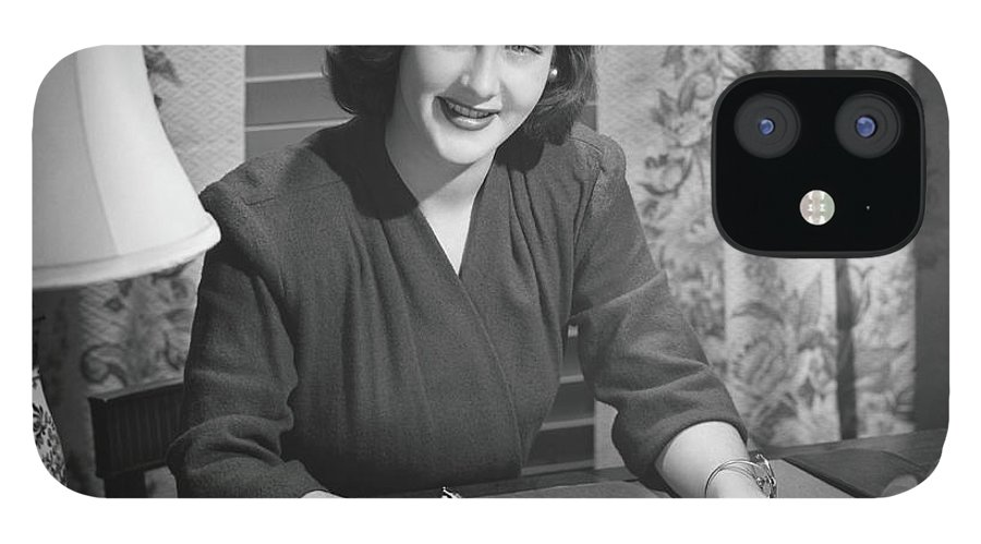 People iPhone 12 Case featuring the photograph Young Woman Writing Letter At Desk, B&w by George Marks