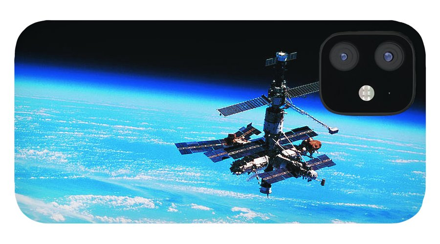 Alertness iPhone 12 Case featuring the photograph A Space Station Orbiting Above Earth by Stockbyte