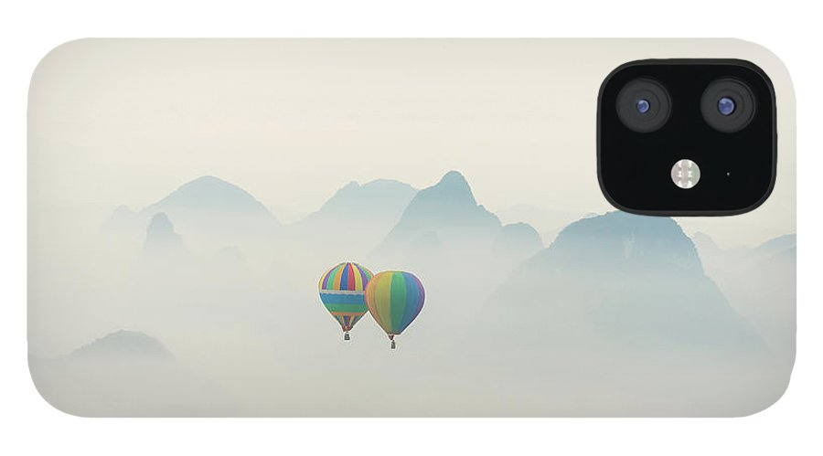 Scenics IPhone 12 Case featuring the photograph Hot Air Balloon Ride At Dawn Over Karst by Alex Linghorn