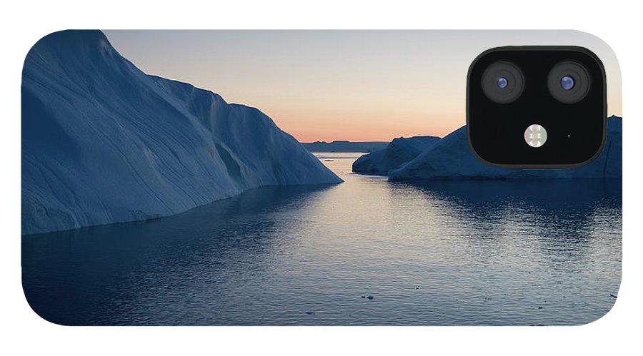 Melting iPhone 12 Case featuring the photograph Icebergs Of Ilulissat Kangerlua by Holger Leue