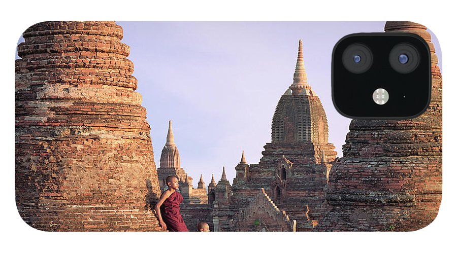 Child IPhone 12 Case featuring the photograph Myanmar, Bagan, Buddhist Monks On Temple by Martin Puddy