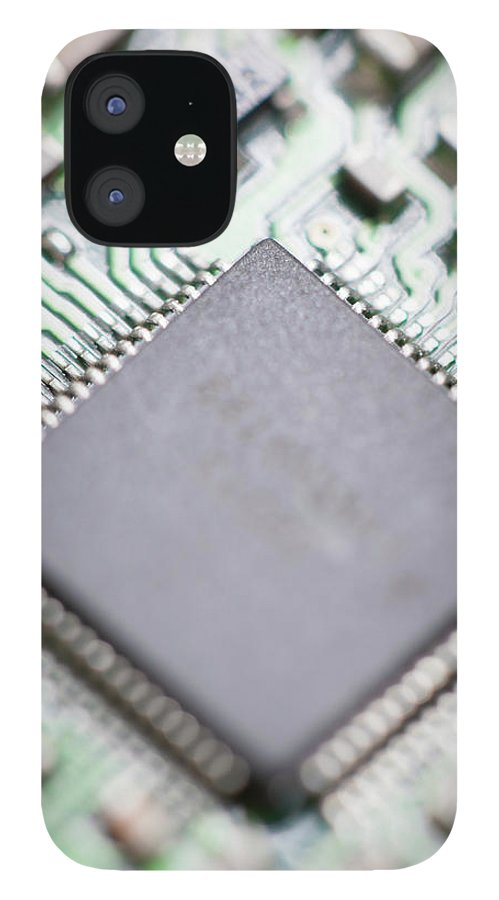 Electrical Component iPhone 12 Case featuring the photograph Close-up Of A Circuit Board by Nicholas Rigg