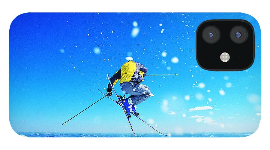 Skiing iPhone 12 Case featuring the photograph Man Skiing by Digital Vision.