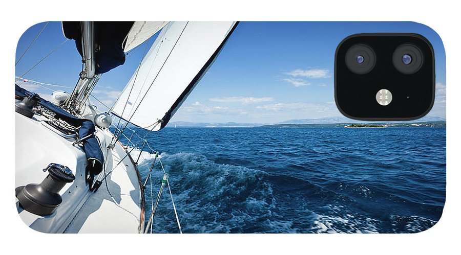 Curve IPhone 12 Case featuring the photograph Sailing In The Wind With Sailboat by Mbbirdy