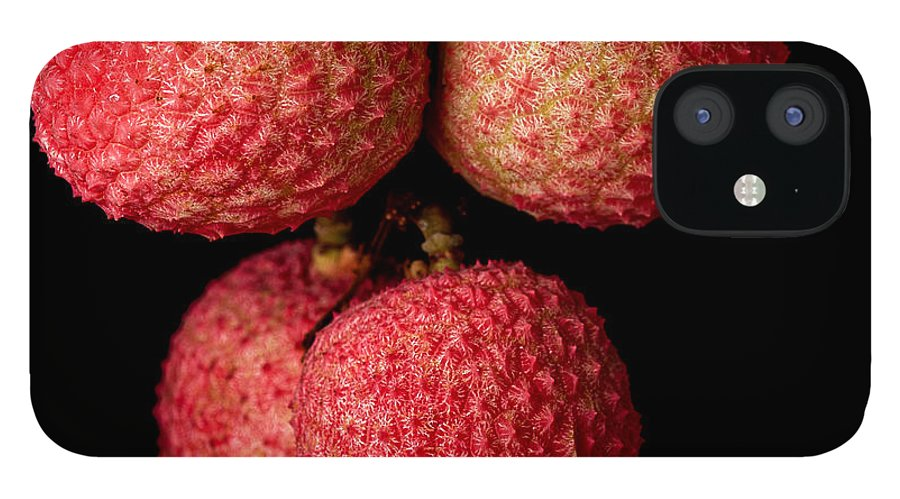 Pink IPhone 12 Case featuring the photograph A Bunch Of Lychees Against A Black by Hein