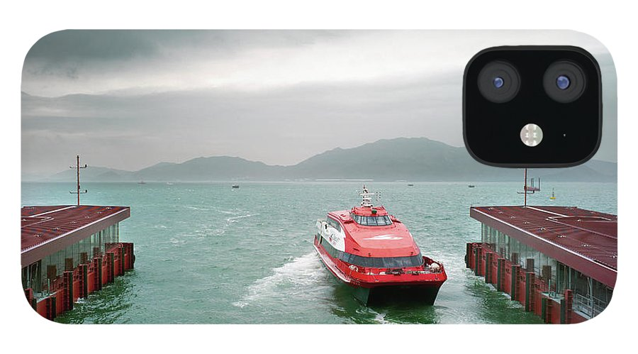 Macao IPhone 12 Case featuring the photograph A Catamaran Ferry Docks At A Port by Xpacifica