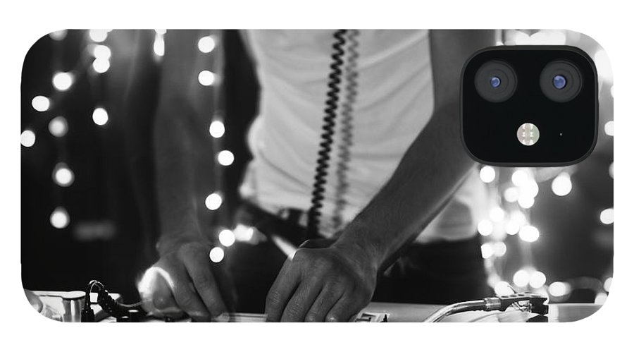 Play iPhone 12 Case featuring the photograph A Cool Male Dj On The Turntables by Dubassy