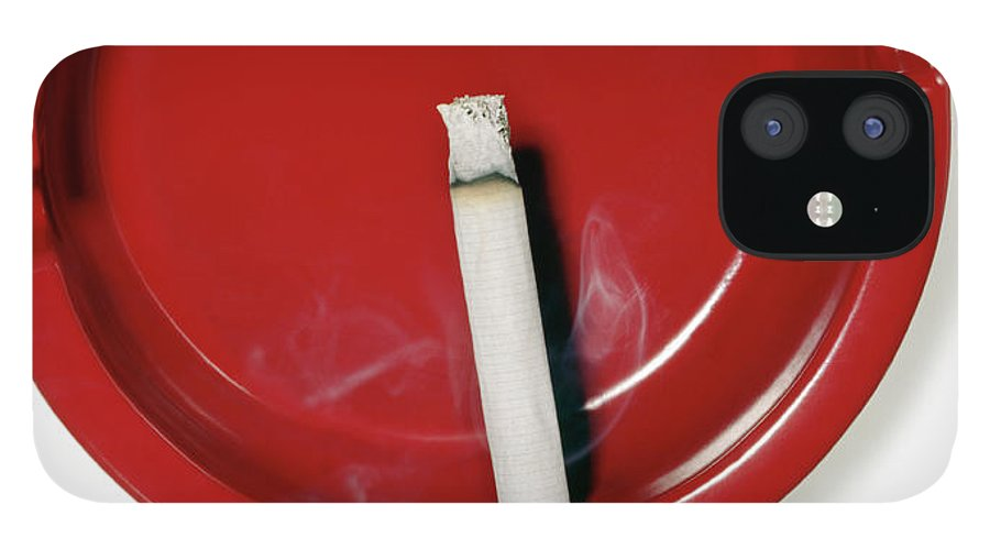White Background IPhone 12 Case featuring the photograph A Red Ashtray With A Burning Cigarette by Steve Wisbauer