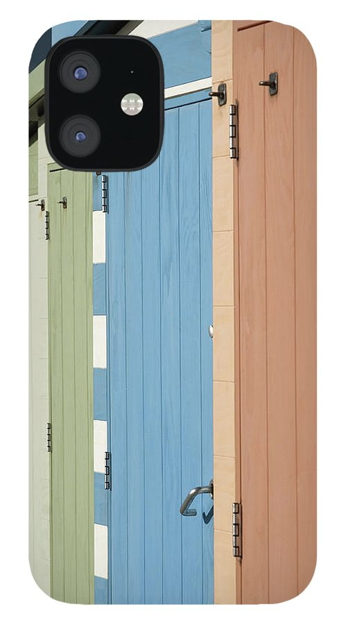 Beach Hut IPhone 12 Case featuring the photograph A Row Of Beach Huts by Matthew Piper