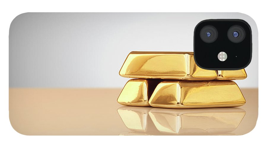 Four Objects IPhone 12 Case featuring the photograph A Stack Of Four Gold Ingots by Anthony Bradshaw