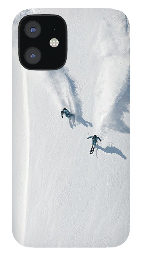 Crash Helmet IPhone 12 Case featuring the photograph Aerial View Of Two Skiers Skiing by Creativaimage