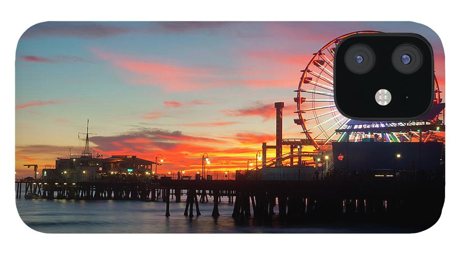 Scenics IPhone 12 Case featuring the photograph Amusement Park On Waterfront At Night by Blend Images/pete Saloutos