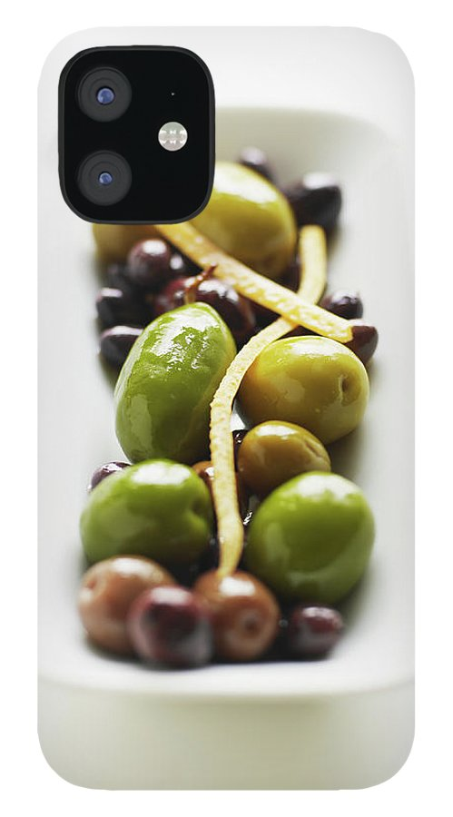 White Background IPhone 12 Case featuring the photograph Appetizer Of Warm Marinated Olives by Thomas Barwick