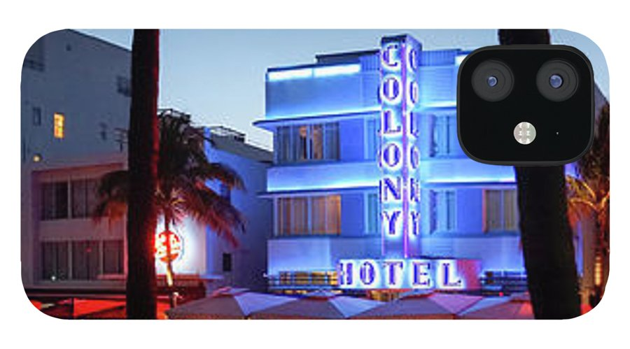 Panoramic IPhone 12 Case featuring the photograph Art Deco Hotels On Ocean Drive At Dusk by Buena Vista Images