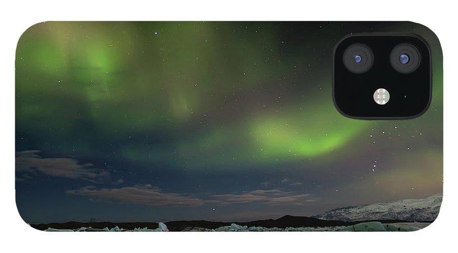 Scenics IPhone 12 Case featuring the photograph Auroras En Jokulsarlon Islandia by Martin Zalba